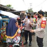 Polsek sukatani laksanakan Giat tematik, dengan membagikan masker kepada Pengguna Jalan